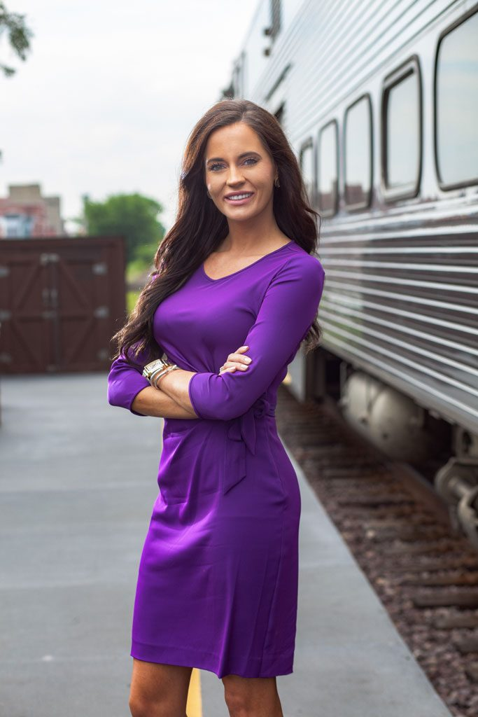 casual headshot photo of woman next to train