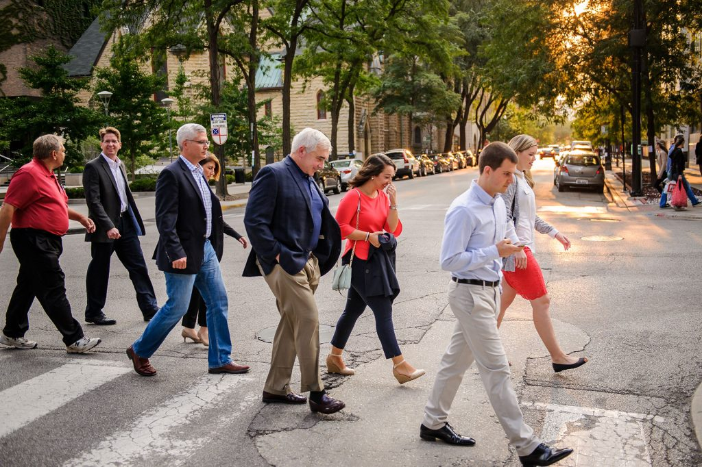 corporate outing photo of people walking to event