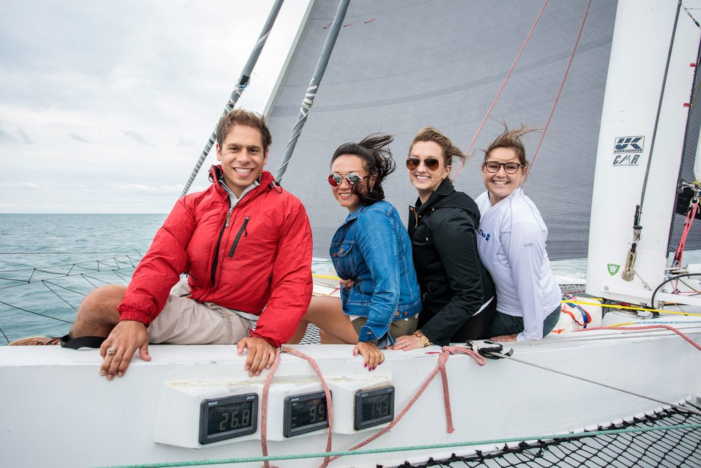 corporate outing photography of people on sailboat