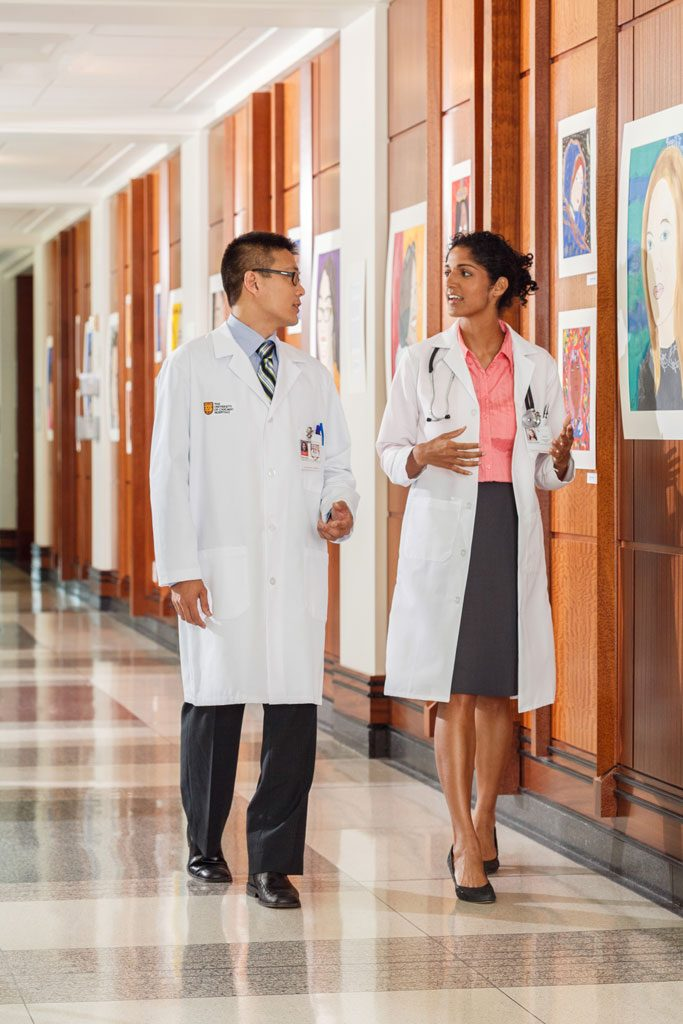 healthcare photo of doctors talking in hallway