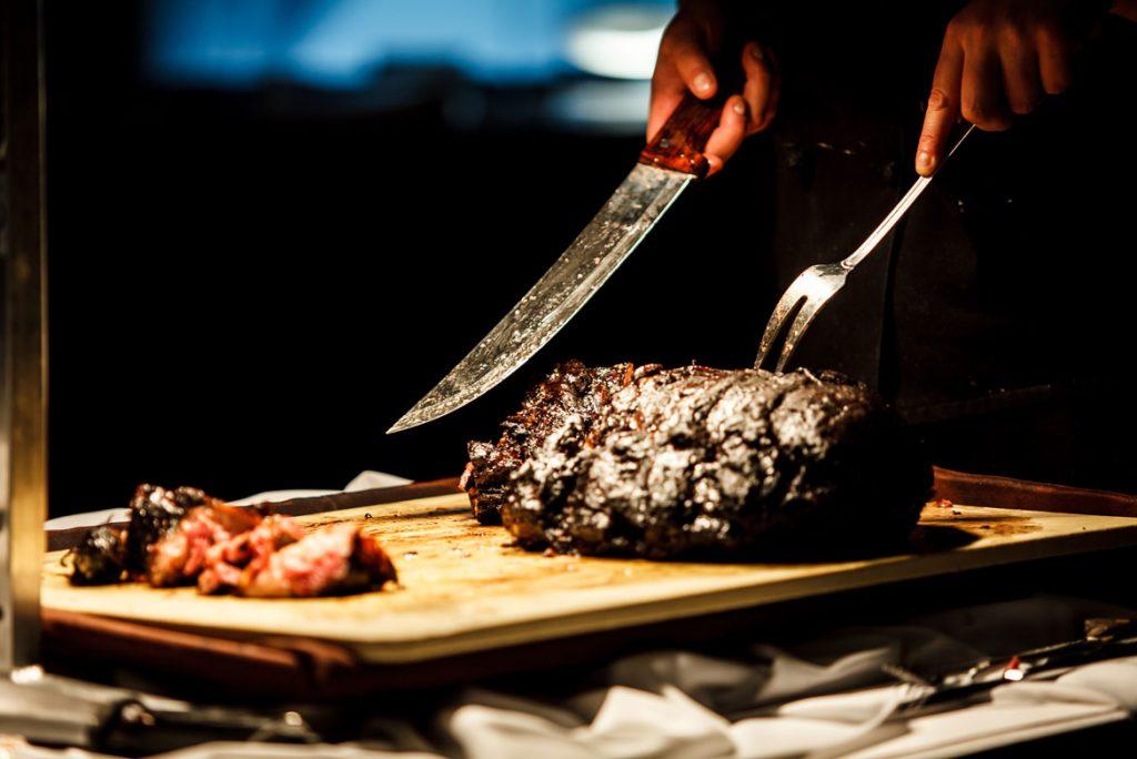 image of chef cutting steak at chicago restaurant