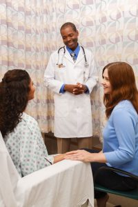 image of doctor meeting with patient