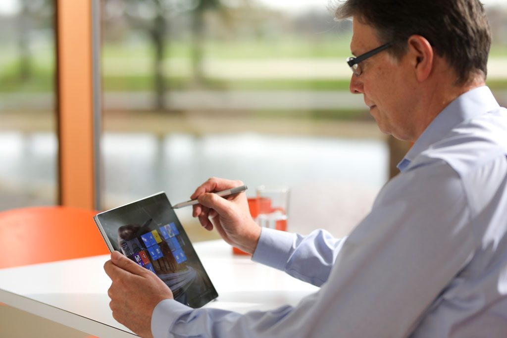 image of man in office working on tablet